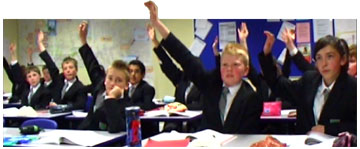 A class of boys with their hands up